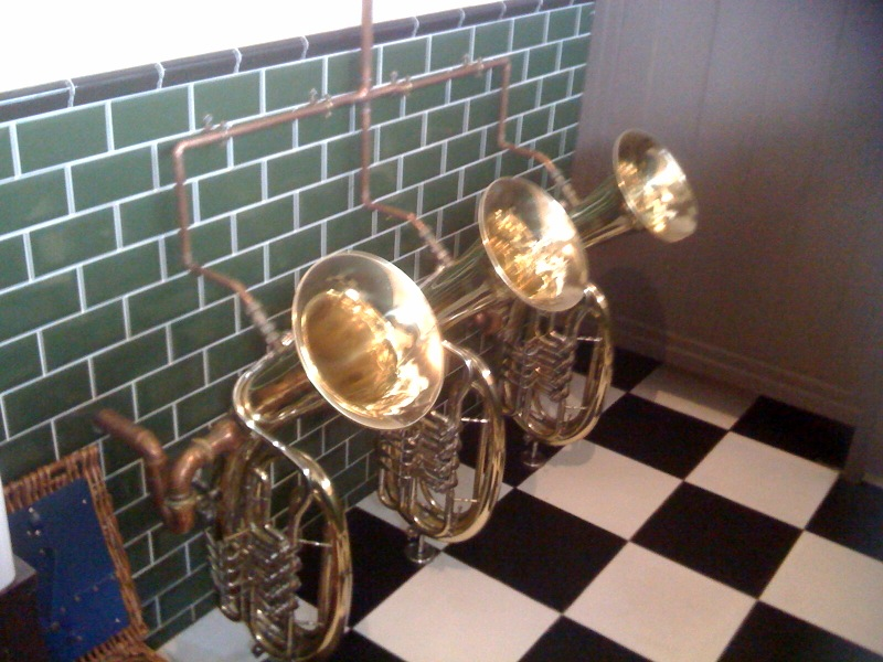 Music themed washroom at venue for New Orleans style jazz funeral